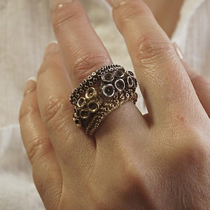 octopus tentacle adjustable ring in silver and brass