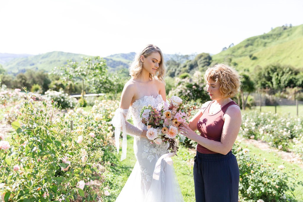 wedding florist with bride and bouquet
