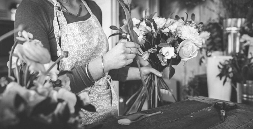 florist making bouquet