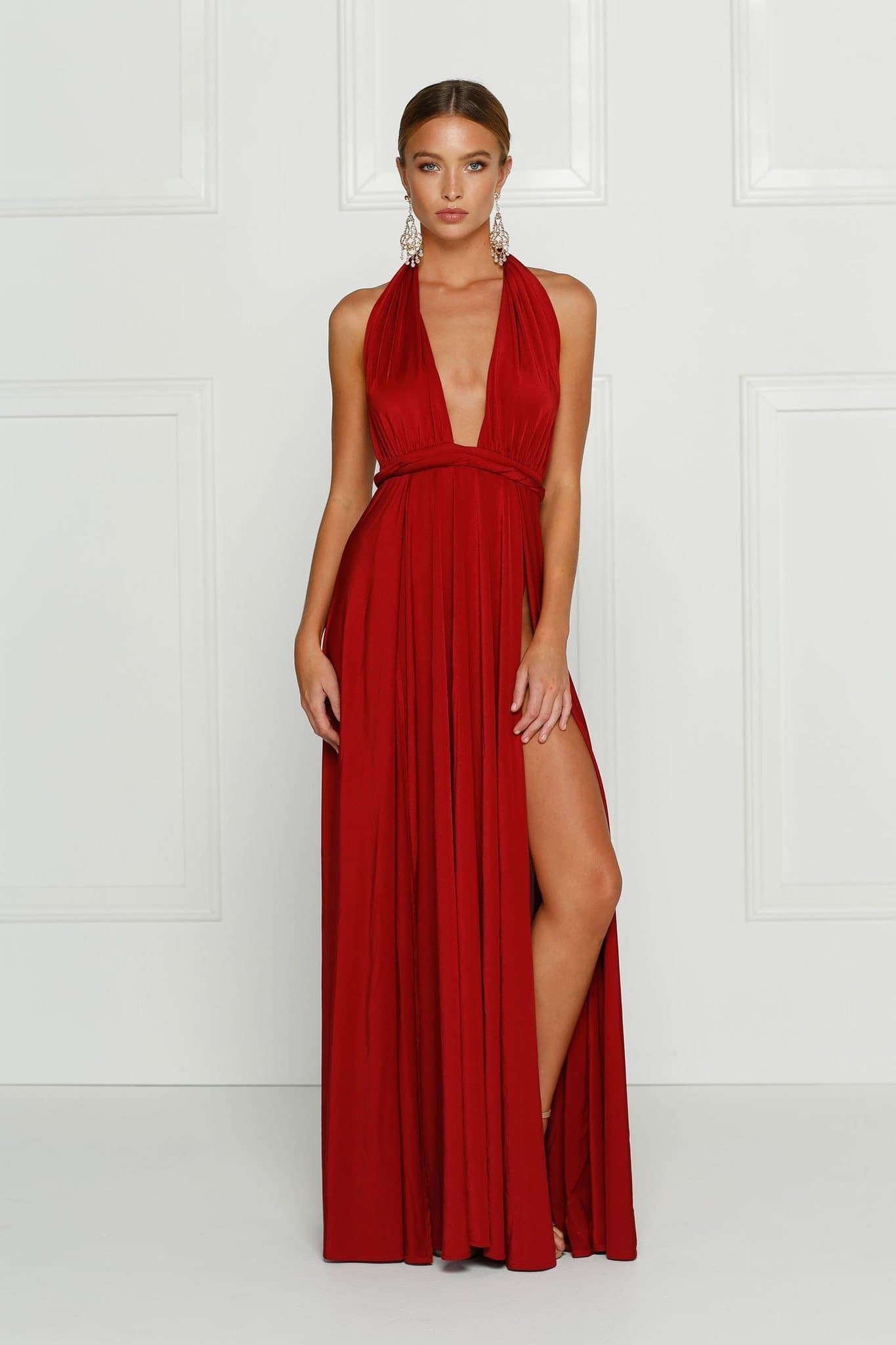 Grecian style wine red maxi made from stretchy jersey with two thigh high splits, adjustable top, low back and full length