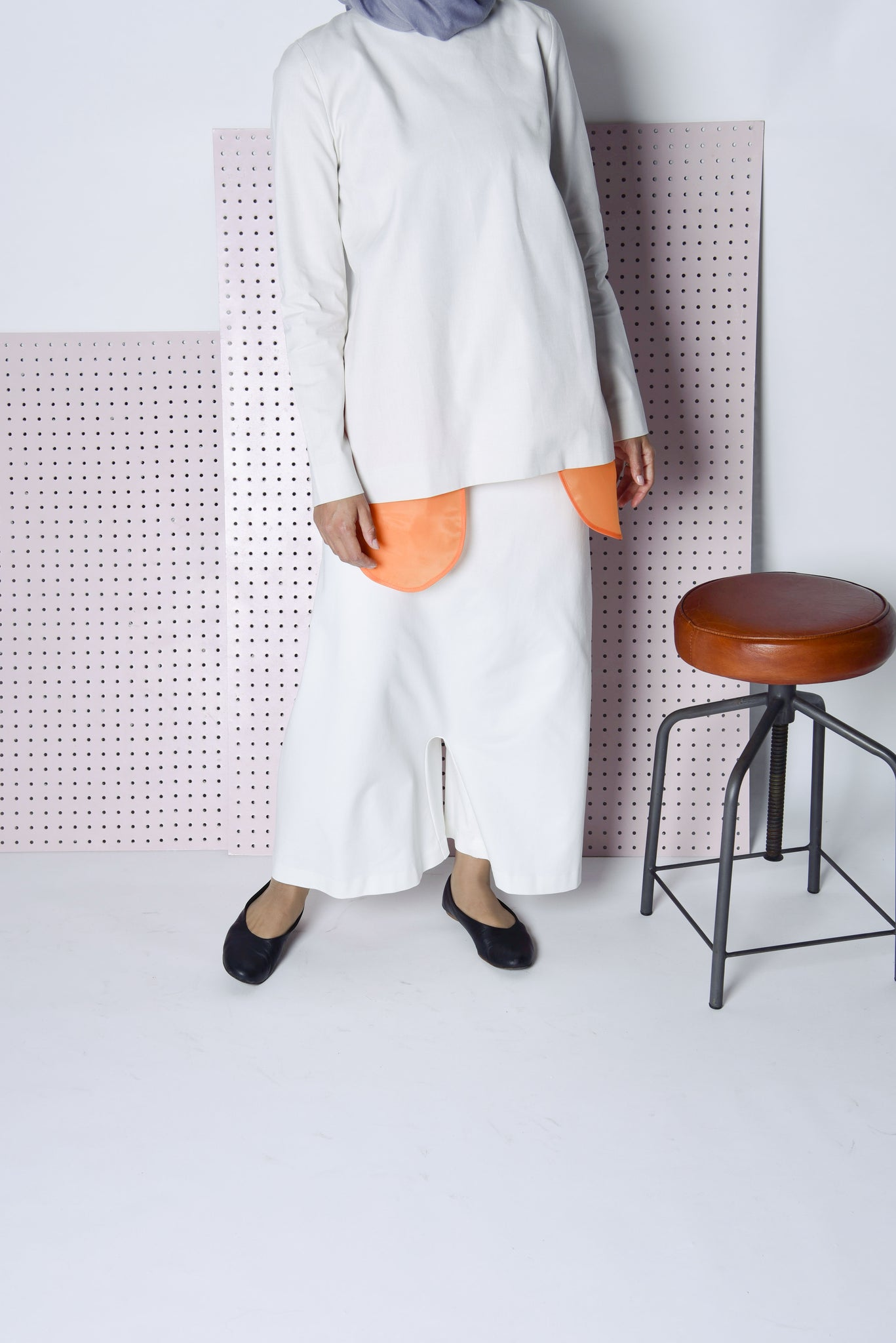 open-back jacket with sheer orange pockets. modern and minimal