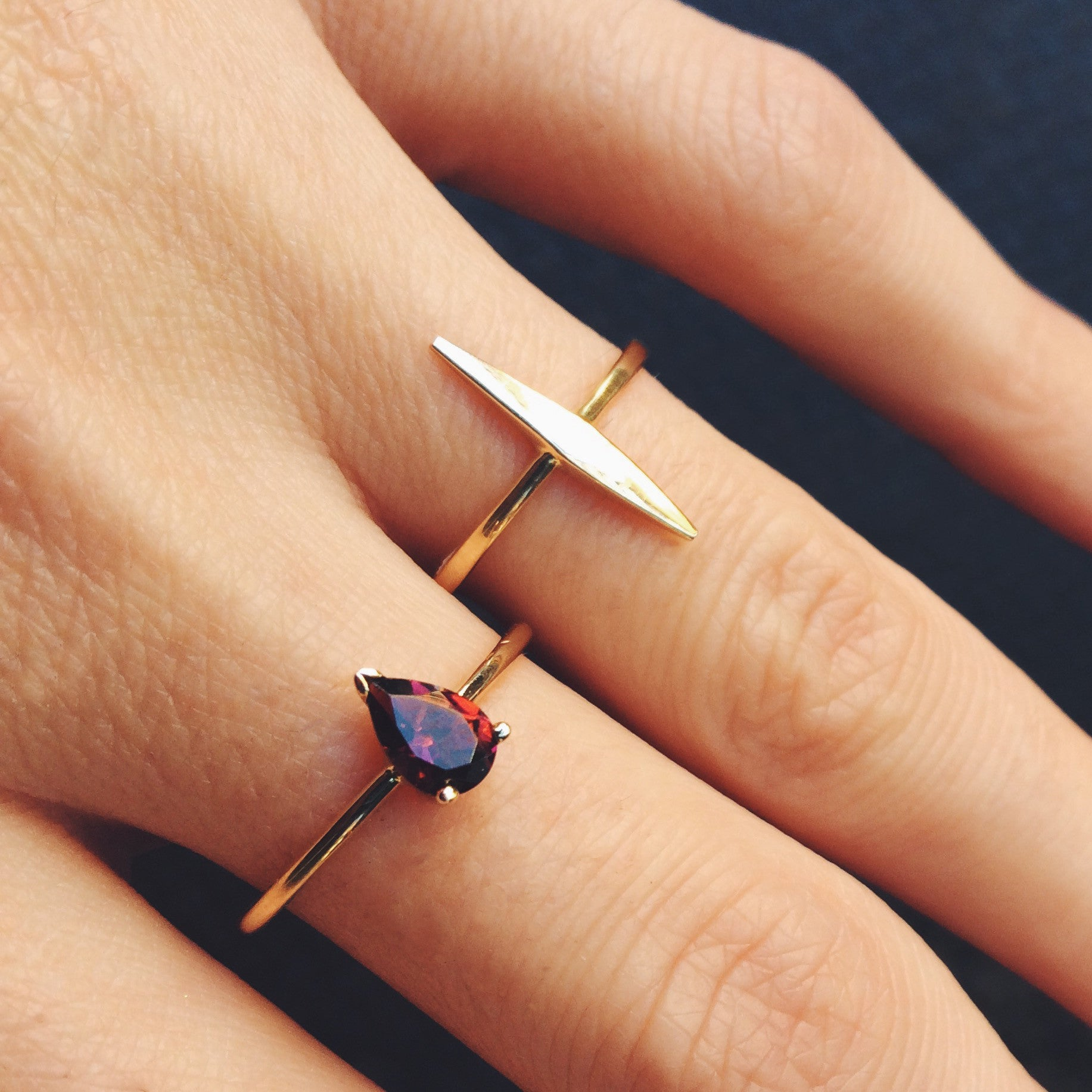 Gold Dart Ring and Tourmaline Ring On Hand