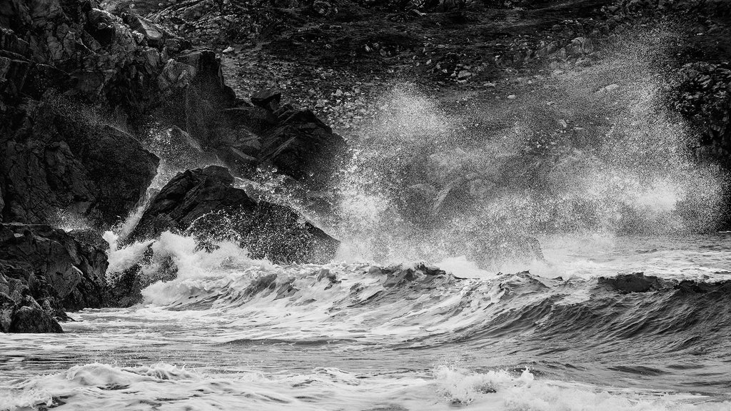 Hebridean sea crashing onto rocks, black and white photograph