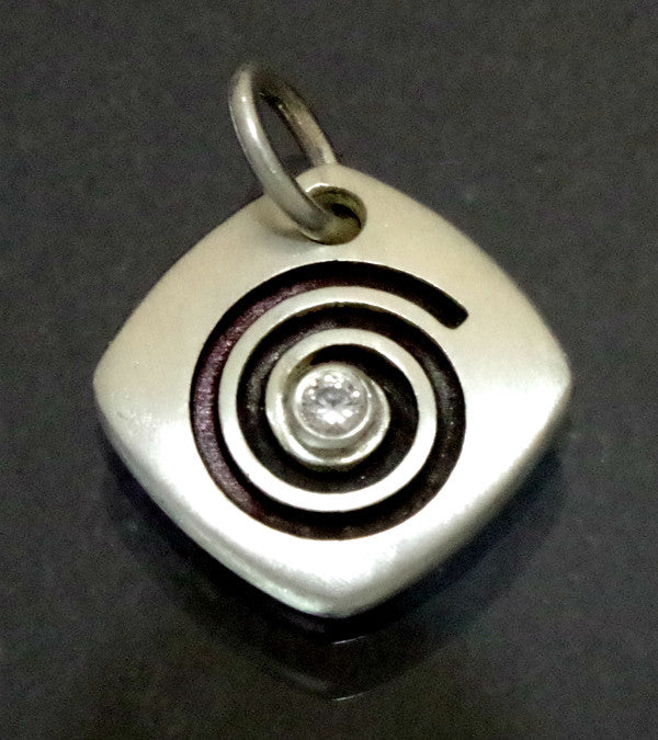 Sterling silver pendant and CZ with spiral symbol
