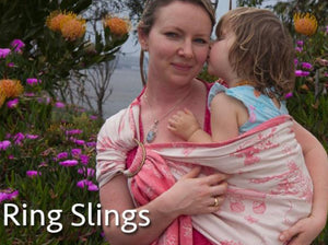woman wearing her toddler in a pink and white gumnut babies ring sling