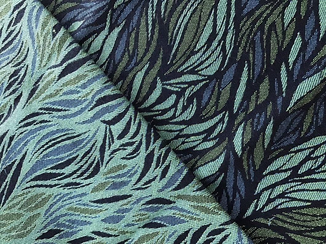 Fabric image green, blue, black aboriginal design of flowingleaves