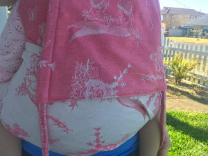 pink and white gumnut babies carrier