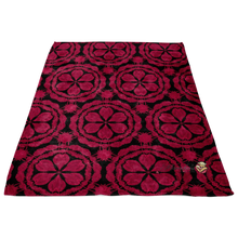 Load image into Gallery viewer, minky blanket in red and black with waratah floral design laying flat