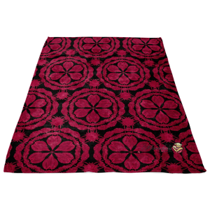 minky blanket in red and black with waratah floral design laying flat