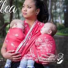 Load image into Gallery viewer, woman wearing twin babies in a coral and cream woven wrap