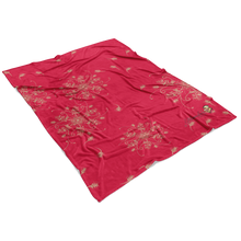 Load image into Gallery viewer, Coral and gold minky blanket with grevillea design laying flat
