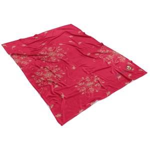 Coral and gold minky blanket with grevillea design laying flat