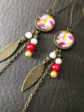LIGHTNESS dangling earrings with pearls and feathers