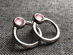 Metal ring and pink glass ball earrings