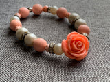 Pink and white bead bracelet with coral flower