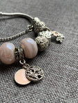 Pink and Silver Charm Bracelet