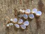 Pink resin stone and white pearl earrings on a gold chain