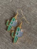 Gold charm sloth on cactus earrings