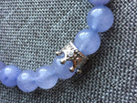 Purple glass ball bracelet and silver crown charm
