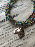 Gold leaf charm bracelet and multicolored resin beads