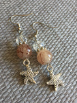 Silver charm earrings with starfish and brown and transparent glass beads