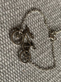 Silver bracelet with bicycle charm