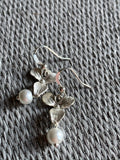 Silver flower and white pearl charm earrings