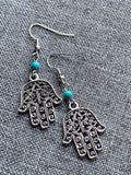 Hand of Fatma symbol charm earrings in silver and turquoise resin ball