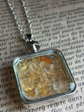 Silver glass charm necklace with yellow stones