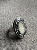Black and beige ring