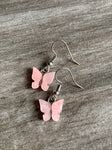 Pink and silver butterfly charm earrings