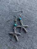 Silver starfish charm earrings and turquoise resin ball