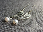 Silver angel wing charm earrings with white pearl