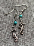 Silver seahorse charm earrings with turquoise resin beads