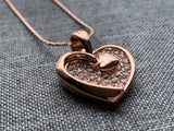 Rose gold heart charm necklace
