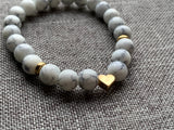 White and gray marbled bead bracelet with gold heart charm