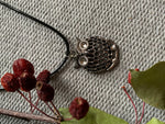 Silver owl charm necklace on black leather cord