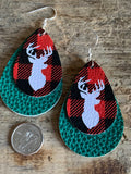 Green deer leather charm earrings on a chalet style background