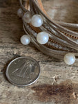 Beige leather wrap bracelet with pearls