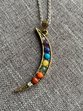 Bronze moon charm necklace and rainbow chackras glass beads