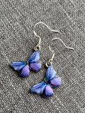 Blue and mauve butterfly charm earrings on silver hook
