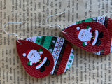 Leather Santa Claus charm earrings on a red and green background
