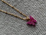 Delicate gold chain necklace and pink butterfly charm