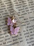 Pale pink and gold butterfly charm earrings