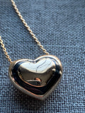 Gold and black metal alloy heart charm necklace