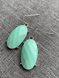 Turquoise stone charm earrings of resin and silver metal alloy
