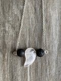 Black lava stone beads and white quartz stone necklace on silver metal alloy chain