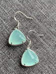 Turquoise stone and silver metal alloy charm earrings