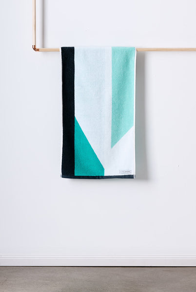 Designer Hand Towel made with 100% Turkish cotton. Features geometric pattern in mint, grey and white.