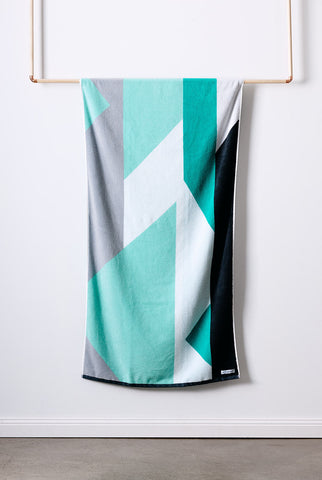 The ENVY Bath Towel is made with Turkish cotton for incredible softness. This turkish towel features a green, mint, white and grey geometric pattern.